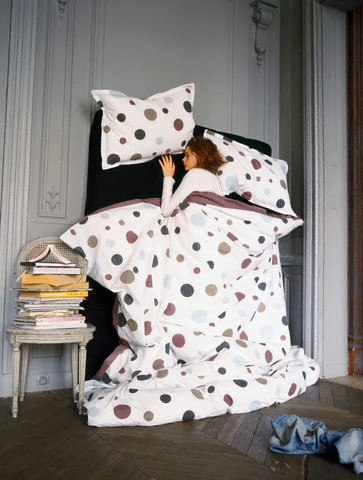 Woman Sleeping in Vertical Bed --- Image by © Coco Amardeil/Corbis