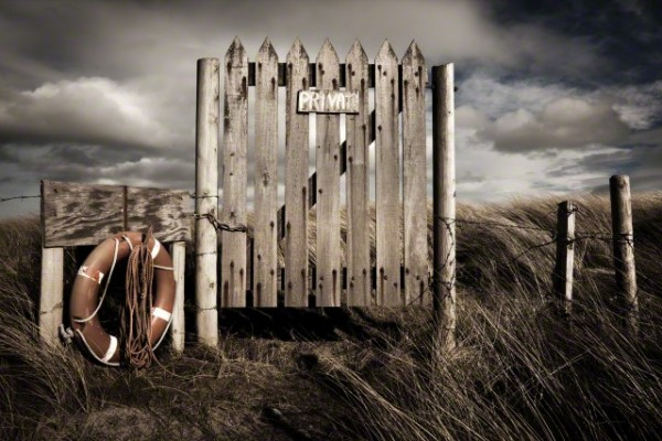 16 Nov 2014, Holy Island, Anglesey, Wales, UK --- A weathered wooden gate reads Private to stop trespassing at an exposed headland at Cymyran, Holy Island, West Anglesey, Wales --- Image by © Glyn Davies/Glyn Davies Photo-Artist Ltd/Corbis
